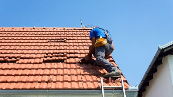One of our professionals repairing a roof